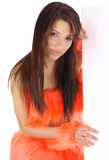 Pretty girl in orange costume Stock Image