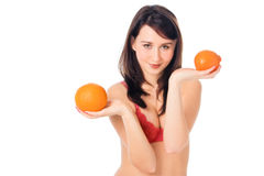 Pretty girl with orange in  hands Stock Photography