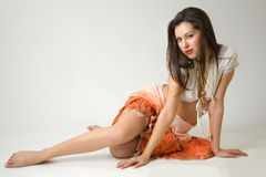 Pretty girl in orange skirt Stock Photography