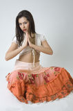 Pretty girl in orange skirt posing in studio Stock Photo