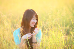 Pretty girl outdoor,beautiful teenage model girl on the field in sun light Royalty Free Stock Photography