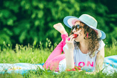Pretty girl outdoor lying on the grass in the park Stock Photography