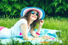 Pretty girl outdoor lying on the grass in the park. Pretty girl lying on the grass outdoor in the park Stock Photography