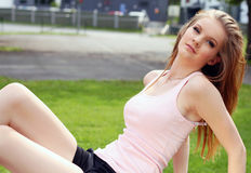 Pretty girl outdoors. Beautiful young woman posing outdoors Royalty Free Stock Photography