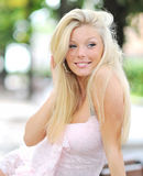 Pretty girl - Outdoors. Pretty girl smiling outdoors - Closeup royalty free stock photo
