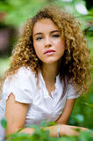 Pretty Girl Outside. A pretty young woman with curly hair outside in park Stock Photography