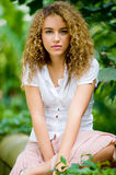 Pretty Girl Outside. A beautiful young woman with great curly hair outside Stock Photography
