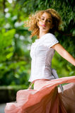 Pretty Girl Outside. A pretty young woman with curly hair outside in park Royalty Free Stock Images