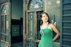 Pretty girl outside building Stock Photo