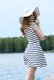 Pretty girl outside in white with hat stock image