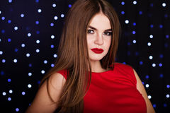 Pretty girl over christmas lights background stock photography