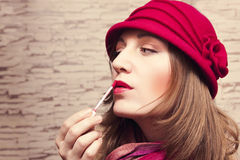 Pretty girl paint her lips Royalty Free Stock Image
