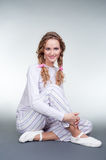 Pretty girl in pajamas and slippers Royalty Free Stock Images