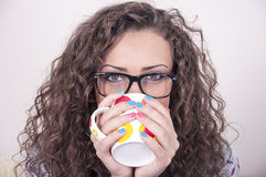 Pretty girl in pajams holding a cup Stock Images