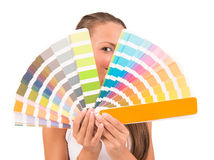 Pretty girl between palette of colors Stock Photo