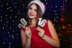 Pretty girl is paper digits 2016, Christmas time Stock Images