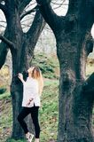 A pretty girl in a park with big trees royalty free stock photos
