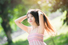 Pretty girl in the park with sunshine day Stock Photography