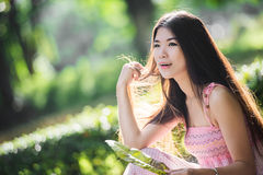 Pretty girl in the park with sunshine day Stock Image