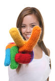 Pretty Girl Peace Sign. A pretty, young girl signaling a peace sign with rainbow gloves royalty free stock photos