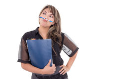 Pretty girl with pen between her mouth and nose Royalty Free Stock Images