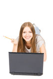 Pretty girl with pencil and laptop Stock Image