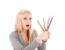 Pretty girl with pencils royalty free stock photo