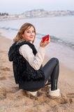 Pretty Girl with Phone on the Beach Stock Photography
