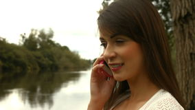 Pretty girl on a phone call stock video