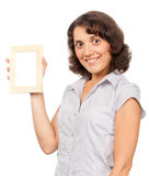 Pretty girl with a photo frame Stock Images