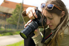 A pretty girl photographer Stock Photography
