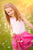 Pretty Girl Picking Flowers. Pretty little girl picking flowers Stock Photo