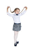 Pretty girl with pigtails. A pretty girl with pigtails stands against the white background Stock Photos