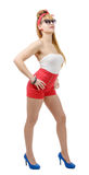 Pretty girl pin-up in shorts on white Stock Images