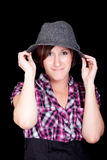 Pretty Girl in a Pink and Black Shirt and a Hat Royalty Free Stock Photo