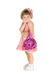 Pretty girl in pink dress with handbag stock images