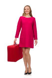 The pretty girl in pink dress holding suitcase isolated on white Stock Photography