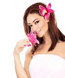 Pretty girl with pink flowers Stock Image