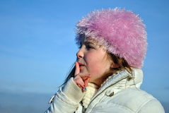 Pretty girl with a pink fluffy hat Royalty Free Stock Photos