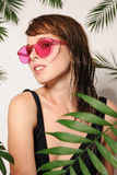 Pretty girl in the pink glasses Royalty Free Stock Images