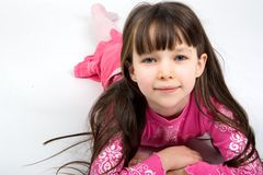 Pretty Girl in Pink Pajamas. Pretty little girl with long, dark hair, ready for bed, in her pink pajamas Stock Photography
