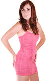 Pretty girl in pink short dress. Stock Photography