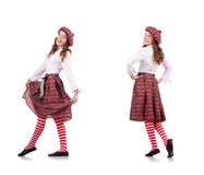 The pretty girl in plaid red clothing isolated on white Royalty Free Stock Image