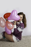 Girl with heart baloon Stock Image
