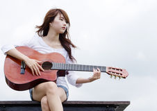 Pretty girl play guitar. Thai pretty girl play the nylon string guitar Royalty Free Stock Photos
