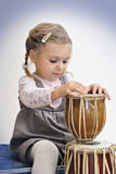 Pretty girl playing the african drums Stock Photos