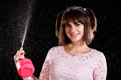Pretty girl playing with an atomizer Royalty Free Stock Photo