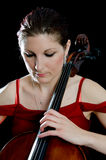 Pretty girl playing the cello Royalty Free Stock Photos
