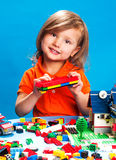 Pretty girl playing with construction blocks Royalty Free Stock Photos