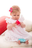 Pretty girl playing with cup toy Royalty Free Stock Images